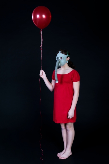 Girl In Gas Masks Holds a Red Ballon